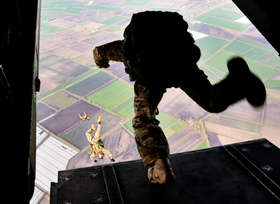 U.S. Air Force Air Commandos assigned to the 321st Special Tactics Squadron execute a military free fall from a CV-22 Osprey, March 17, 2017, over RAF Mildenhall, England. The exercise also included Air Commandos performing free falls from an MC-130J Commando II and allows flight crew and 321st STS members to practice safely deploying from aircraft to reach designated drop zones. (U.S. Air Force photo by Senior Airman Justine Rho)