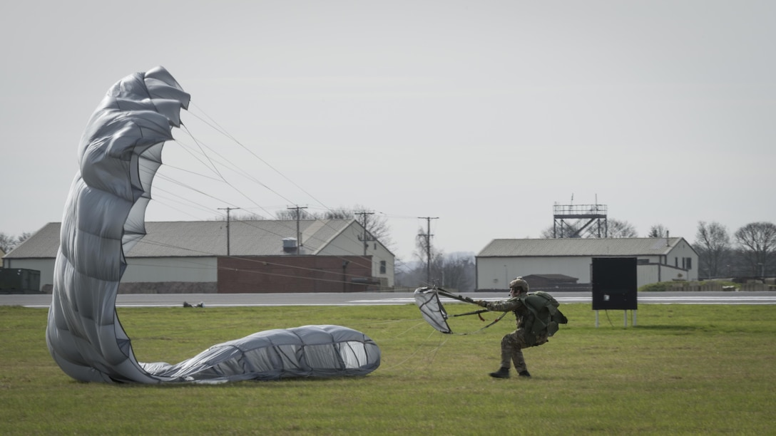 A U.S. Air Force Air Commando from the 321st Special Tactics Squadron recovers his parachute after performing a military free fall from an MC-130J Commando II March 17, 2017, over RAF Mildenhall, England. Airmen from the 352d Special Operations Wing exercised the procedure from MC-130J and CV-22 Osprey aircraft to allow aircrews and special tactics airmen the opportunity to practice the procedure in a controlled environment. (U.S. Air Force photo by Capt Chris Sullivan)