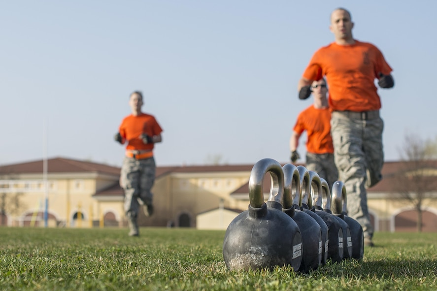 A group of 31st Munitions Squadron Airmen participate in the first Combat Warrior Challenge at Aviano Air Base, March 16, 2017. The teams competed head-to-head, through a series of obstacles that tested physical strength and mental toughness. (U.S. Air Force photo by Senior Airman Cory W. Bush)