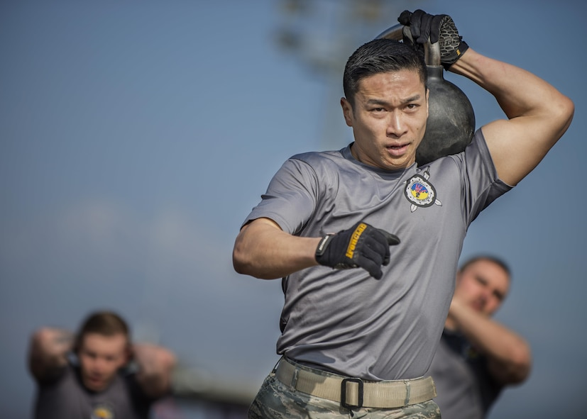 Staff Sgt. Ly Wong, 31st Communications Squadron, participates in the first Combat Warrior Challenge at Aviano Air Base, March 17, 2017. Among several obstacles, one required teams to carry six kettlebells 100 yards. (U.S. Air Force photo by Senior Airman Cory W. Bush)