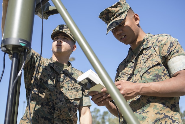 Cpl. Timothy Brooks (left) and Lance Cpl. Christopher Ruaboro, meteorological and oceanographic (METOC) forecasters with Battle Space and Surveillance Company, 1st Intelligence Battalion, I Marine Expeditionary Force, use the automated weather operating system to record weather observations for their weekly, 24-hour METOC observer certification exercise at Marine Corps Base Camp Pendleton, Mar 14, 2017. The weather forecasts provided by the METOC Marines assist commanders in air, sea or ground operations. Brooks is a native of Rockville, Maryland, and Ruaboro is a native of Lihue, Hawaii. (U.S. Marine Corps photo by Lance Cpl. Justin Bowles)
