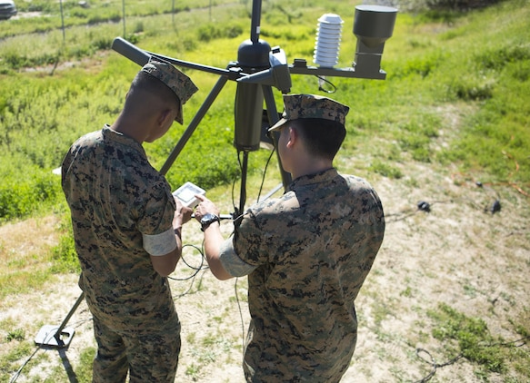 Lance Cpl. Christopher Ruaboro (left) and Cpl. Timothy Brooks, meteorological and oceanographic (METOC) forecasters with Battle Space and Surveillance Company, 1st Intelligence Battalion, I Marine Expeditionary Force, use the automated weather operating system to record weather observations for their weekly, 24-hour METOC observer certification exercise at Marine Corps Base Camp Pendleton, Mar 14, 2017. The weather forecasts provided by the METOC Marines assist commanders in air, sea or ground operations. Brooks is a native of Rockville, Maryland, and Ruaboro is a native of Lihue, Hawaii. (U.S. Marine Corps photo by Lance Cpl. Justin Bowles)