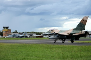 A U.S. Air Force F-16 Fighting Falcon and a Royal Australian Air Force F-18A Hornet taxi at Royal Australian Air Force Base Williamtown in New South Wales, Australia, during exercise Diamond Shield 2017, March 21, 2017. Air Force photo by Tech. Sgt. Steven R. Doty