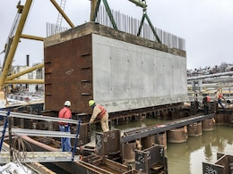 The $70.5 million work on monoliths M22 to M27 is part of the $2.7-billion Lower Monongahela Locks and Dams 2, 3, 4, or Lower Mon Project. The work underway at Charleroi involves building new middle and river walls that comprise a new riverside lock chamber.