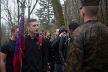 Staff Sgt. Michael Murray, SNCOIC of Recruiting Sub-Station Gresham, talks with poolees before they began their walk up Angel's Rest Hiking Trail, Portland, March 18, 2017. The poolees climbed 1,450 feet in elevation to the peak of the trail as a way to prepare for the physical demands of Marine Corps Recruit Training. (U.S. Marine Corps Photo by Sgt. Taylor Morton/Released)