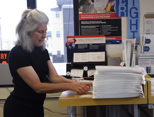 Sharon McCrea, Malmstrom Air Force Base postmaster, straightens address labels for customers at the base contract postal unit March 21, 2017, at Malmstom Air Force Base, Mont. McCrea is a one-person shop, but hopes to eventually expand her team once she grasps the aspects of what people need. (U.S. Air Force photo/Senior Airman Jaeda Tookes)