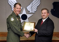 Former Electronic Systems Center Commander Lt. Gen. Ted Bowlds presents the Senior Level certificate to Dr. Tim Rudolph March 7, 2008, during a ceremony at Hanscom. Rudolph, who was most recently serving as the Air Force Life Cycle Management Center Chief Techology Officer, will be departing Hanscom at the end of the month and shared highlights of collaboration efforts that occurred during his tenure. (U.S. Air Force photo by Mark Wyatt)