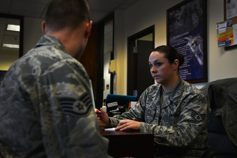 U.S. Air Force Staff Sgt. Rachael Phillips, 20th Force Support Squadron reenlistments noncommissioned officer in charge, helps a customer at Shaw Air Force Base, S.C., March 20, 2017. The reenlistments office of the military personnel section helps service members to extend, reenlist and receive any bonuses they may be entitled to upon reenlistment. (U.S. Air Force photo by Airman 1st Class Destinee Sweeney)