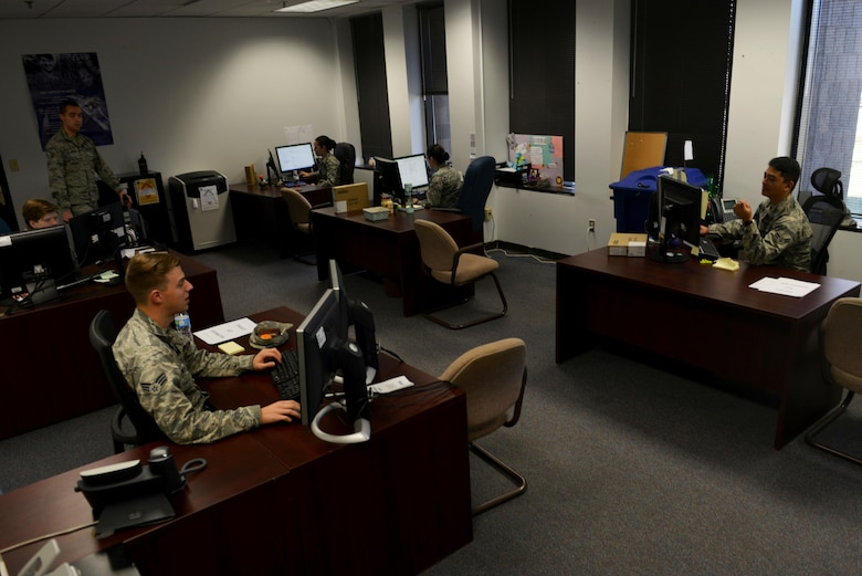U.S. Airmen assigned to the 20th Force Support Squadron evaluations office work on enlisted performance report (EPR) packages at Shaw Air Force Base, S.C., March 20, 2017. The evaluations Airmen are responsible for reviewing and submitting EPRs to the Air Force Personnel Center. (U.S. Air Force photo by Airman 1st Class Destinee Sweeney)