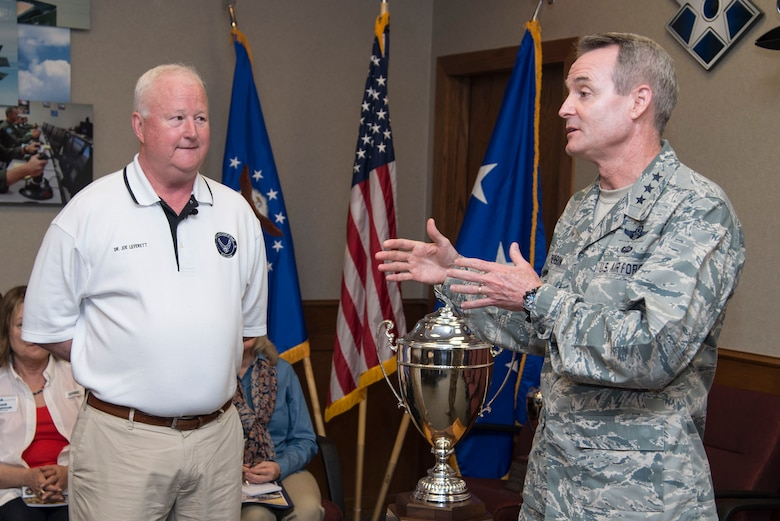 Lt. Gen. Darryl Roberson, commander of Air Education and Training Command, and Dr. Joe Leverett , provided background information on the significance of the Altus Trophy during the AETC Commander's Civic Leader Group tour March 22, 2017, at Joint Base San Antonio-Randolph, Texas.  The trophy is presented annually to the community judged to have provided the top support to an AETC base. (U.S. Air Force photo by Sean Worrell)