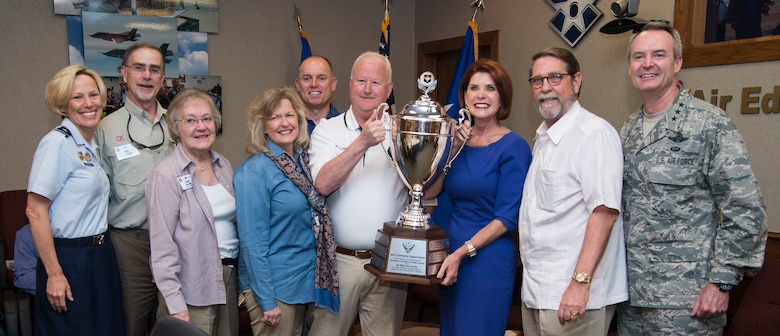 Lt. Gen. Darryl Roberson, commander of Air Education and Training Command, (at right), announced San Antonio, Texas, as the 2016 Altus Trophy winner. Brig. Gen. Heather Pringle, 502nd Air Base Wing commander, (at left), Diane Rath, Alamo Area Council of Governments executive director, (third from right) and other San Antonio civic leaders were in attendance to receive the trophy. The Altus Trophy is given to the community judged to have shown outstanding support to an AETC base. (U.S. Air Force photo by Sean Worrell)