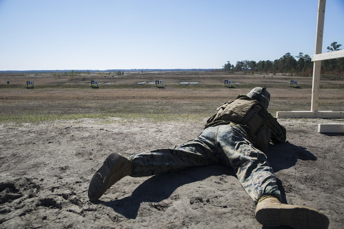 Sgt. Daniel Grant, a mortarman with Special Purpose Marine Air-Ground Task Force - Southern Command, assumes the prone position while firing at an unknown distance target on a Table 3 range during pre-deployment training at Range K501 aboard Marine Corps Base Camp Lejeune, North Carolina, March 16, 2017.  The training was conducted to enhance the Ground Combat Element's readiness for future security cooperation operations in Central America. (U.S. Marine Corps photo by Cpl. Melissa Martens/ Released)