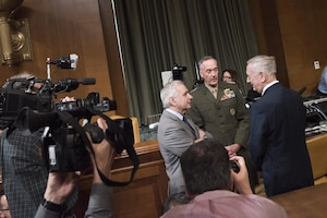Defense Secretary Jim Mattis and Marine Corps Gen. Joe Dunford, chairman of the Joint Chiefs of Staff, speak with Rhode Island Senator Jack Reed at the Senate Appropriations Defense Subcommittee hearing on Capitol Hill, March 22, 2017. DoD photo by Navy Petty Officer 2nd Class Dominique A. Pineiro