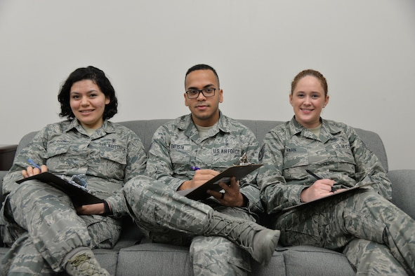 Airman 1st Class Yolanda Alvarez Hernandez, left, Senior Airman Ricardo Batista, center, and Staff Sgt. Allison Hahn, 341st Medical Operations Support Squadron mental health professionals, pose for a photo at the clinic March 21, 2017, at Malmstrom Air Force Base, Mont. The daily duties of these Airmen include taking care of patients who need support while dealing with stressful situations. (U.S. Air Force photo/Airman 1st Class Daniel Brosam)