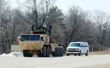 """Soldiers at Fort McCoy for the Operation Cold Steel exercise participate in exercise operations March 17, 2017, at Fort McCoy, Wis. Operation Cold Steel's purpose is to qualify select gun crews to support """"Objective-T"""" requirements for Army Early Response Forces, or AERF. Army Reserve forces, which are part of the overall AERF contingency forces, are part of the Army plan to provide a force that can deploy on short notice to respond to contingencies when needed. (U.S. Army Photo by Scott T. Sturkol, Public Affairs Office, Fort McCoy, Wis.)"""