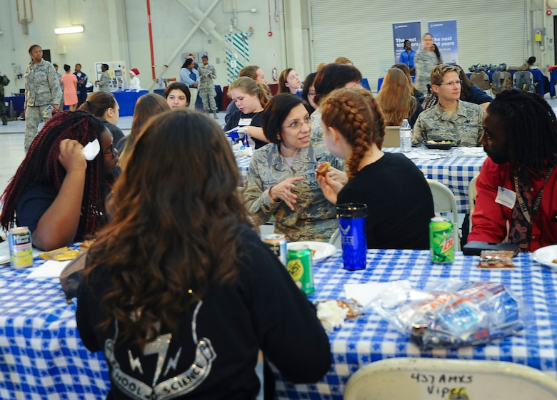 Air Force Reserve Command Chief Master Sgt. Ericka Kelly (front table) and Chief Master Sgt. Wendy Blevins, Directorate of logistics, Engineering and Force Protectionchief enlisted manager (rear table) speak with students at the 10th Annual Joint Base Charleston Women in Aviation Career Day March 20 at Joint Base Charleston, S.C.