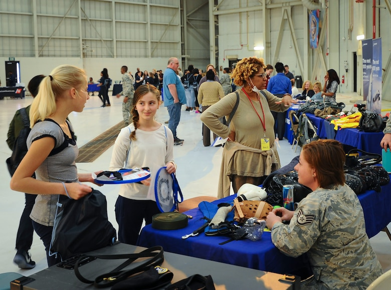 Staff Sgt. Angela Loew, 628th Security Force Squadron military working dog handler, speaks to girls at the 10th Annual Joint Base Charleston Women in Aviation Career Day March 20 at Joint Base Charleston, S.C. (U.S. Air Force Photo by Senior Airman Tom Brading)