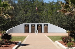 The Explosive Ordinance Disposal Memorial Wall was constructed at Eglin Air Force Base, Fla., in honor of fallen EOD service members in 1999. U.S. Navy, U.S. Marine Corps, U.S. Army and U.S. Air Force EOD technicians must attend and graduate the same school in order to be eligible for assistance. (Courtesy Photo)