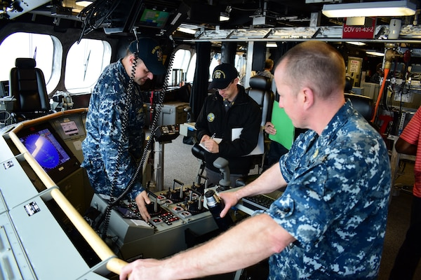 170313-N-VV532-002  PACIFIC OCEAN (March 13, 2017) Lt. j.g. John Homola demonstrates the ship control console functionality to a Board of Inspection and Survey (INSURV) inspector during final contract trials for littoral combat ship USS Montgomery (LCS 8). Montgomery is the fourth littoral combat ship of the Independence variety which features an innovative trimaran hull, designed to offer unparalleled stability for marine and aviation operations in severe sea states.  (U.S. Navy photo by Electronics Technician 1st Class Adam Ross/Released)
