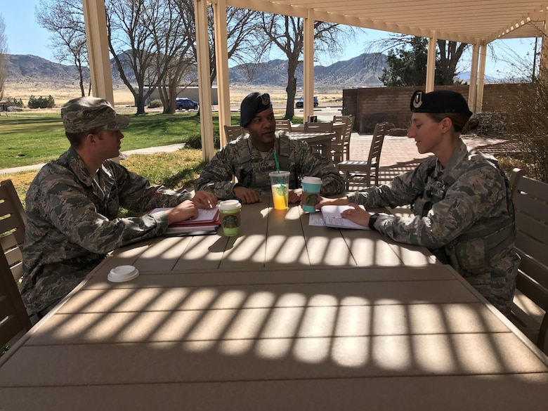 1st Lt. Corey Fox, Master Sgt. Darryl Lyles and 2nd Lt. Brittany Oxley discuss Air Force Assistance Fund campaign preparations at the Tijeras Arroyo Golf Course.  The campaign kicks off March 28 with a burger burn at Marquez Park.
