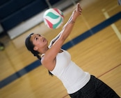 A 96th Force Support Squadron player returns the volleyball back during their intramural game with the 96th Medical Group March 21 at Eglin Air Force Base, Fla.  The MDG dominated winning in two games, 25-12 and 25-14.  (U.S. Air Force photo/Samuel King Jr.)