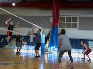A 96th Medical Group player goes up for a spike during their intramural volleyball game with the 96th Force Support Squadron March 21 at Eglin Air Force Base, Fla.  The MDG dominated winning in two games, 25-12 and 25-14.  (U.S. Air Force photo/Samuel King Jr.)