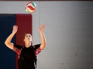 A 96th Medical Group player prepares to serve during their intramural volleyball game with the 96th Force Support Squadron March 21 at Eglin Air Force Base, Fla.  The MDG dominated winning in two games, 25-12 and 25-14.  (U.S. Air Force photo/Samuel King Jr.)