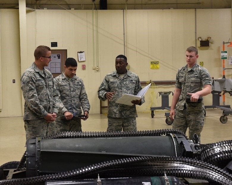U.S Air Force Tech. Sgt. Tavaras Schoultz, 372nd Training Squadron Detachment 4 instructor, evaluates his students on proper weapons systems maintenance at Tyndall Air Force Base, Fla., March 16, 2017. Schoultz was presented with the 2016 Instructor of the Year award at the Maintenance Professional of the Year awards ceremony in February. (U.S. Air Force photo by Airman 1st Class Cody R. Miller/Released)