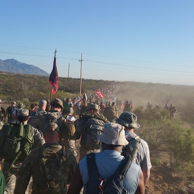 Participants in the Bataan Memorial Death March trek through the desert of White Sands Missile Range, New Mexico, March 19, 2017. The Bataan Memorial Death March commemorates the infamous 65-mile forced march of more than 60,000 American and Filipino troops during World War II. (Courtesy Photo) (U.S. Air National Guard photo by Tech. Sgt. Michael Matkin)