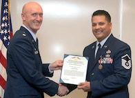 Master Sgt. Patrick Colclasure, right, receives a Meritorious Service Medal from Lt. Col. Michael Drost, the 71st Operations Support Squadron commander, during a retirement ceremony held March 17, at Vance Air Force Base, Oklahoma. (U.S. Air Force photo/ Terry Wasson)