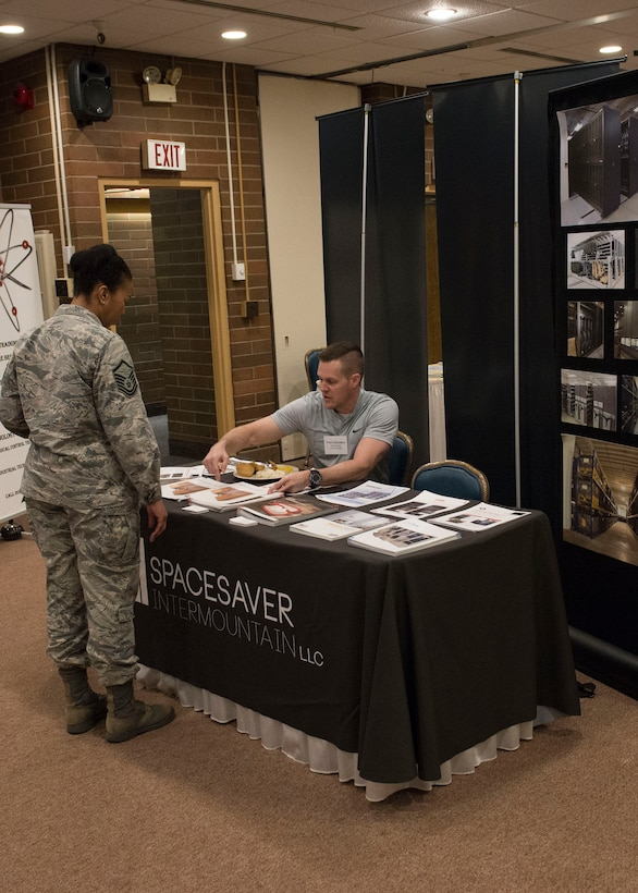 A vendor explains what his business offers at the vendor fair, March 16, 2017, at Mountain Home Air Force Base, Idaho. This annual event gives MHAFB the ability to get to know local businesses and what they're capable of.(U.S. Air Force photo by Airman Jeremy D. Wolff/Released)