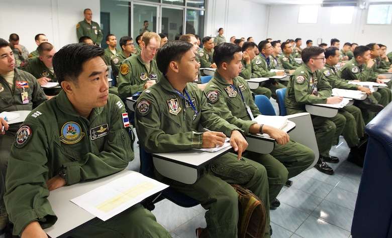 Pilots from the Royal Thai air force (RTAF), Republic of Singapore air force (RSAF), and U.S. Air Force (USAF) listen during a mission briefing for exercise Cope Tiger 2017 at Korat Royal Thai Air Force Base, Thailand, March 21, 2017. Over 1,200 U.S., Thai and Singaporean military members will participate in CT17. The annual multilateral exercise is aimed at improving combined combat readiness and interoperability between the Republic of Singapore air force, Royal Thai air force, and U.S. Air Force, while concurrently enhancing the three nations' military relations. (U.S. Air Force photo by Staff Sgt. Kamaile Chan)