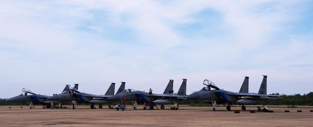 U.S. Airmen with the 18th Wing from Kadena Air Base, Japan prepare F-15 aircraft for missions during exercise Cope Tiger 2017 at Korat Royal Thai Air Force Base, Thailand, March 21, 2017. The annual multilateral exercise, which involves a combined total of 76 aircraft and 43 air defense assets, is aimed at improving combined combat readiness and interoperability between the Republic of Singapore air force, Royal Thai air force, and U.S. Air Force, while concurrently enhancing the three nations' military relations. (U.S. Air Force photo by Staff Sgt. Kamaile Chan)