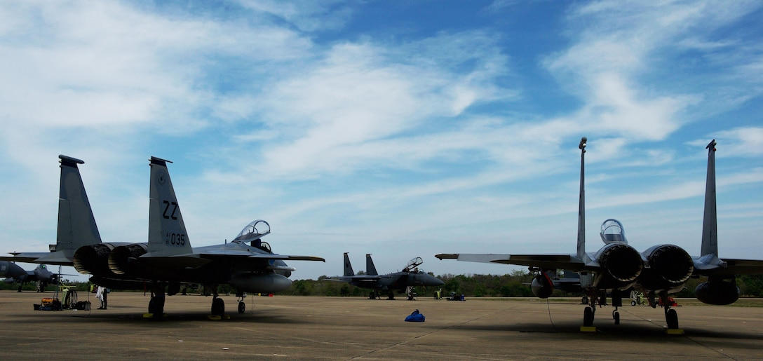 U.S. Air Force F-15 aircraft assigned to the 18th Wing from Kadena Air Base, Japan, sit across from a Republic of Singapore air force F-15 aircraft in preparation for large formation exercises during Cope Tiger 2017 at Korat Royal Thai Air Force Base, Thailand, March 21, 2017. The annual multilateral exercise, which involves a combined total of 76 aircraft and 43 air defense assets, is aimed at improving combined combat readiness and interoperability between the Republic of Singapore air force, Royal Thai air force, and U.S. Air Force, while concurrently enhancing the three nations' military relations. (U.S. Air Force photo by Staff Sgt. Kamaile Chan)