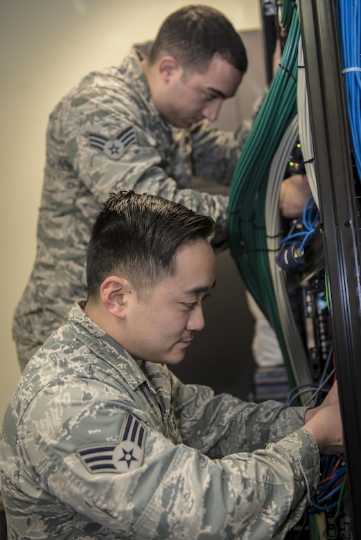 U.S. Air Force Senior Airman Jeffrey Fujita, a knowledge management technician with the 7th Air Force Combined Battle Watch at Osan Air Base, Republic of Korea, bottom, and Senior Airman Eric Roman, a knowledge management technician with the 747th Communications Squadron at Joint Base Pearl Harbor-Hickam, Hawaii, top, troubleshoot network issues for the commander's staff during Key Resolve 2017 at Osan Air Base, ROK, March 22, 2017. Responsible for the coordination and distribution of information and data, knowledge management specialists play a critical role in every department of the Air Force and are vital to command and control exercises such as Key Resolve. (U.S. Air Force photo by Staff Sgt. Benjamin W. Stratton)