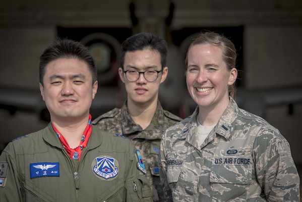 Republic of Korea Air Force Capt. Sangbo Min, a search and rescue duty officer, left, and ROKAF Senior Airman Seung Hwan Kowith, an interpreter, center, both with the ROKAF Airlift and Rescue Branch, pose for a photo with U.S. Air Force 1st Lt. Mary Daughenbaugh, right, with the 566th Intelligence Squadron at Buckley Air Force Base, Colorado, during Key Resolve 2017 at Osan Air Base, Republic of Korea, March 21, 2017. These Airmen work side-by-side with other combat search and rescue specialists participating in the annual command and control exercise called Key Resolve. (U.S. Air Force photo by Staff Sgt. Benjamin W. Stratton)