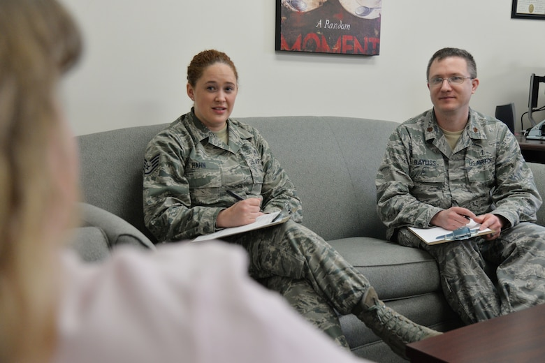 Staff Sgt. Allison Hahn, 341st Medical Operations Squadron NCO in charge of mental health, and Maj. Corey Bayliss, 341st MDOS Alcohol and Drug Abuse Prevention and Treatment program manager, speak to a patient March 21, 2017, at Malmstrom Air Force Base, Mont. Mental health technicians assist 50-75 patients a week. (U.S. Air Force photo/Airman 1st Class Daniel Brosam)