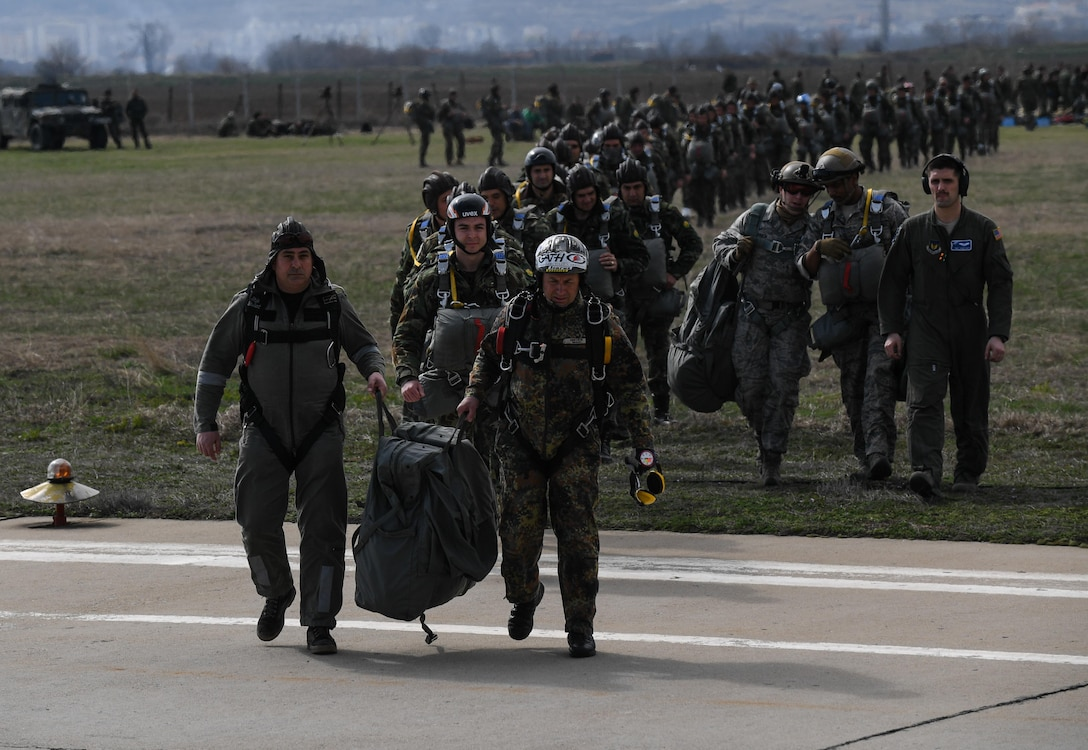 Exercise Thracian Spring 17 personnel load a C-130J Super Hercules in preparation for a personnel drop during Exercise Thracian Spring 17 at Plovdiv Regional Airport, Bulgaria, March 20, 2017. Airmen from the 37th Airlift Squadron, 435th Contingency Response Group, and 86th Airlift Wing, Ramstein Air Base, Germany, partnered with the Bulgarian military for the two-week exercise. The U.S. shares a commitment with Bulgaria, a NATO ally, to promote peace and close cooperation on countering a range of regional and global threats. (U.S. Air Force photo by Staff Sgt. Nesha Humes)