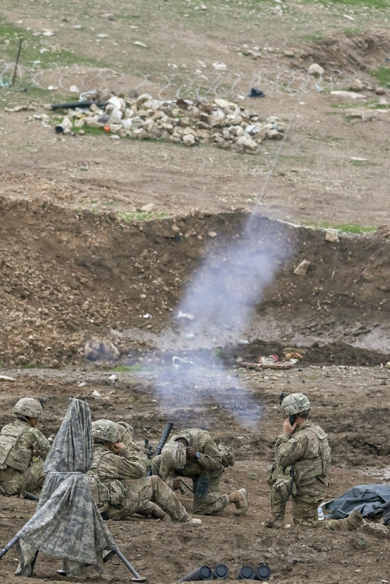U.S. Army mortarmen, deployed in support of Combined Joint Task Force-Operation Inherent Resolve and assigned to 2nd Brigade Combat Team, 82nd Airborne Division, fire mortars in support of 9th Iraqi Army Division near Al Tarab, Iraq, during the offensive to liberate West Mosul from ISIS, March 18, 2017. The 2nd BCT, 82nd Abn. Div., enables their Iraqi security forces partners through the advise and assist mission, contributing planning, intelligence collection and analysis, force protection, and precision fires to achieve the military defeat of ISIS. CJTF-OIR is the global Coalition to defeat ISIS in Iraq and Syria. (U.S. Army photo by Staff Sgt. Jason Hull)