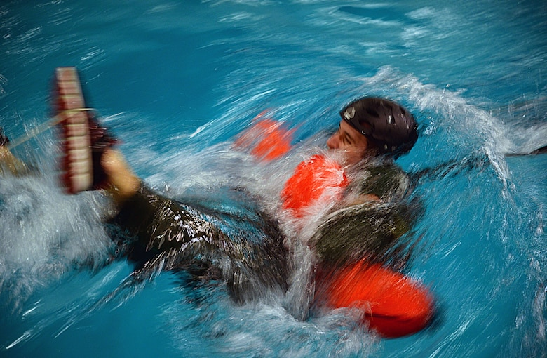 A U.S. Air Force Airman gets pulled through the water during Water Survival Training March 10, 2017, at Lowestoft College, Maritime and Offshore Facilities, England. This exercise focused on what it would be like being pulled through the water if attached to a parachute and how to escape. (U.S. Air Force photo by Senior Airman Christine Halan)