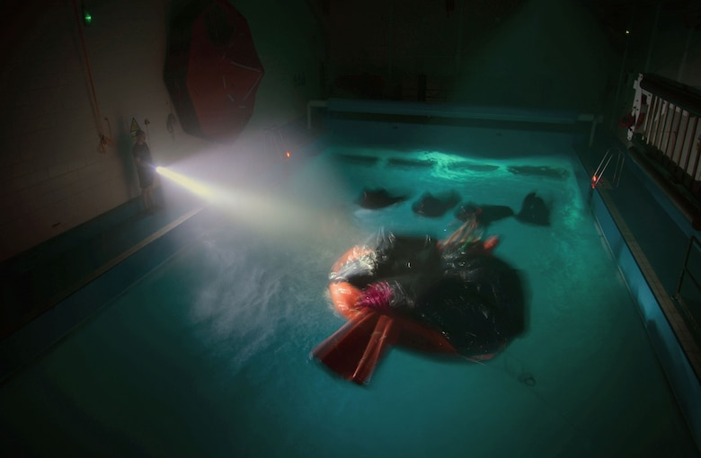 U.S. Air Force Airmen undergo an exercise during Survival, Evasion, Resistance and Escape Water Survival Training March 10, 2017, at Lowestoft College, Maritime and Offshore Facilities, England. Once Airmen are instructed on how to properly survive in the water, they're put through an exercise to test their survival skills. (U.S. Air Force photo by Senior Airman Christine Halan)