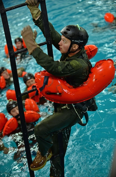 A U.S. Air Force Air Commando from the 352nd Special Operation Wing, climbs a ladder during Survival, Evasion, Resistance and Escape Water Survival Training March 10, 2017, at Lowestoft College, Maritime and Offshore Facilities, England. Climbing the ladder simulated what it would be like to climb into an aircraft if stuck in the middle of the ocean. (U.S. Air Force photo by Senior Airman Christine Halan)