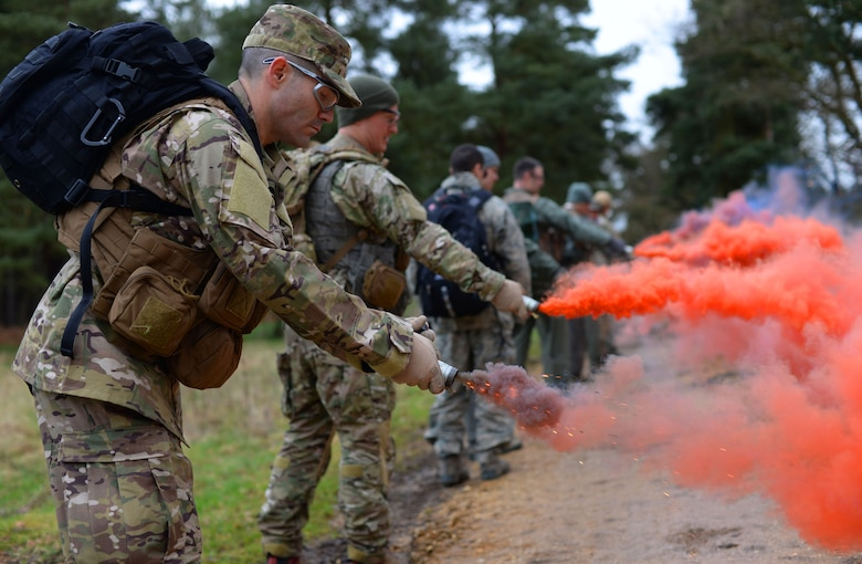 U.S. Air Force Airmen from the 100th Air Refueling Wing, and 352nd Special Operations Wing from RAF Mildenhall, England, and 48th Fighter Wing from RAF Lakenheath, England, test smoke bombs March 8, 2017, at the Stanford Training Area, England. Every three years the Airmen must undergo survival, evasion, resistance and escape training to maintain proficiency. (U.S. Air Force photo by Senior Airman Christine Halan)