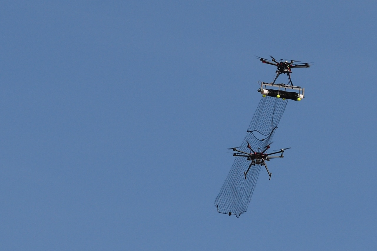 An attack drone with attached net, part of the counter-unmanned aerial system developed by a team from Wright-Patterson Air Force Base, Ohio, intercepts a DJI S1000 drone with its net during the 2016 Air Force Research Laboratory Commanders Challenge at the Nevada National Security Site in Las Vegas, Dec. 13, 2016. Teams had six months to develop a counter-unmanned aerial system to aid in base defense. At a CSIS meeting on space security on March 22, 2017, Navy Vice Adm. Charles A. Richard, deputy commander of U.S. Strategic Command, said space enables all domains and tools of warfare, including ships, jets, missiles and drones. Air Force photo by Wesley Farnsworth
