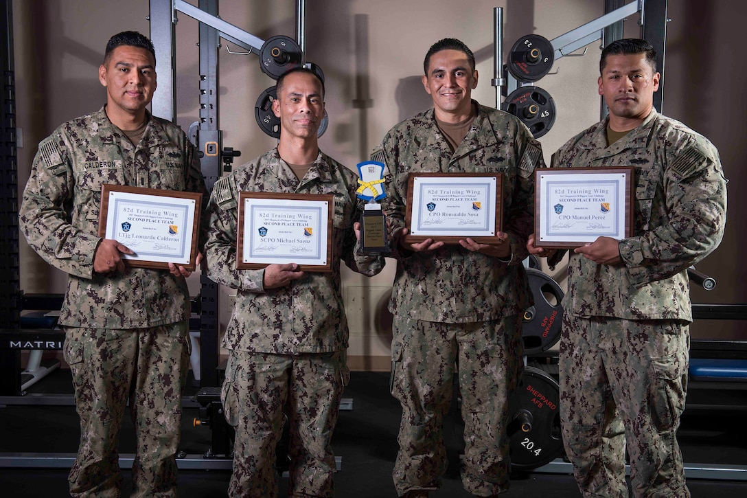 The U.S. Navy team 'Sea Cows,' was awarded second place in the Sheppard Air Force Base, Texas, Biggest Loser Challenge, March 9, 2017. This team is made up of U.S. Navy Lt. j.g. Leo Calderon, Senior Chief Petty Officer Michael Saenz, Chief Petty Officer Manuel Perez and Chief Petty Officer Romualdo Sosa. (U.S. Air Force photo by Staff Sgt. Kyle E. Gese)
