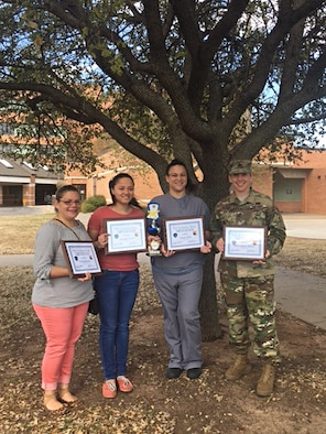 First Place was awarded to team 'Booty Busters,' for the Sheppard Air Force Base, Texas, Biggest Loser Challenge March 9, 2017. On the team was U.S. Army Sgt. 1st Class Ammy Belser, Stacie Turk, Vivian Rivera and Zenaida Ford. (U.S. Air Force courtesy photo)
