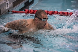 Master Sgt. Armijo finishes the last stretch of the 600 meter swim relay during the Taco Warrior Challenge, Sunday, March 05, 2017 at the Kirtland Air Force Base East Fitness Center swimming pool.