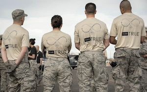 Members of team True stand together during a reprieve between events at the Taco Warrior Challenge, March 05, 2017 at Kirtland Air Force Base, Albuquerque, New Mexico.  The team is named in honor of fallen warrior Major Ryan True, who passed away earlier this year.