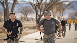 Opposing team leads share a laugh together while breaking away from the pack of runners at the Taco Warrior Challenge Rucksack Run, Sunday, March 05, 2017.  The event was hosted by the New Mexico Air National Guard's 150th Special Operations Wing at Kirtland Air Force Base, Albuquerque, New Mexico.