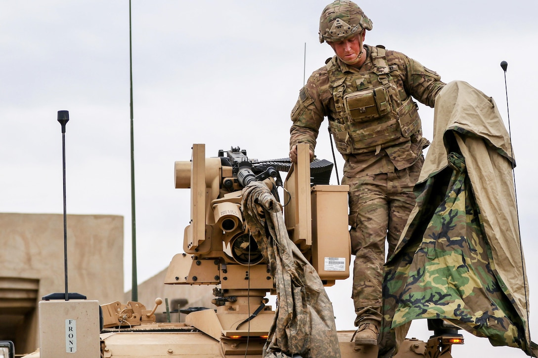 Army Sgt. Thomas Carwell uncovers the common remotely operated weapon system near Tarab, Iraq, March 17, 2017. Carwell is assigned to the 82nd Airborne Division's 2nd Brigade Combat Team, Combined Joint Task Force Operation Inherent Resolve. Army photo by Staff Sgt. Jason Hull